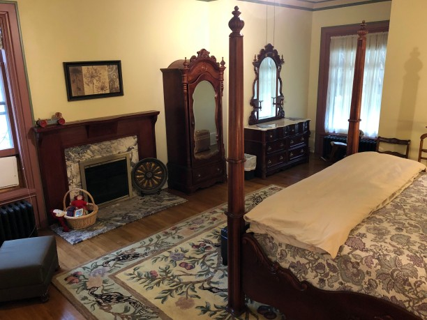 Room 1 with four-poster king-size bed and fireplace mantel